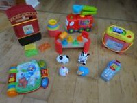 Over 15 infant toys, all clean, working, and with batteries included