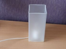 Glass table/bedside lamp. Frosted glass with 25 Watt candle lamp.
