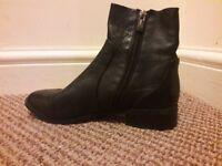 Topshop size 4 black sock boot..worn twice.