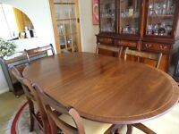 Dining room table, chairs and display cabinet