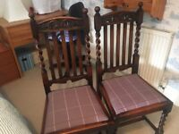 4 ornate dining chairs in solid mahogany wood.