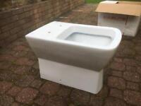 RAK back to wall toilet with soft close seat.