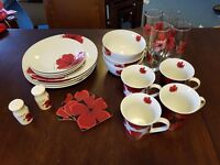 set of red and white poppy pattern crockery. Tableware for 4 place settings
