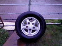 1 landrover alloy wheel, excellent condition with deep tread