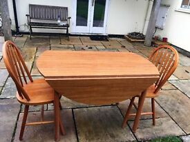 round table drop leaf and 2 chairs