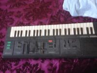 Yamaha PSS 260 electric keyboard with adapter