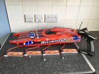 RELENTLESS V2 BRUSHLESS RC BOAT WITH TRANSMITTER AND RECIEVER AND 4 BATTERIES