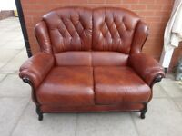 A Brown Italian Leather Two Seater Sofa