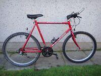 Raleigh cyclone bike, 26 inch wheels, 23 inch frame, 18 gears, red