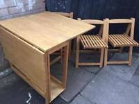 Fold away dinning table and 3 chairs
