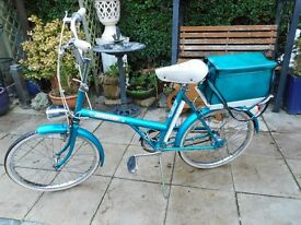 blue vintage raleigh 20 bike with lights and lock