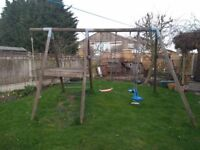 Wooden TP climbing frame with swing