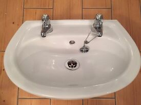 Cloakroom basin and taps