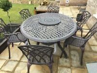 Solid cast aluminium allweather 8 seater oval & 2 seater round table & chairs, cushions and parasol