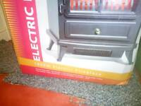 Electric fire with log effect light brand new