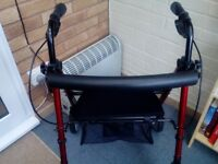 Mobility walker with seat and backrest. Shopping storage under seat
