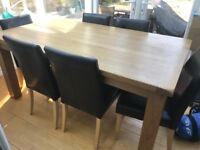 Solid oak table and 6 chairs (happy to sell table alone)