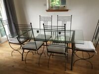 Lovely contemporary dining table and 6 Chairs