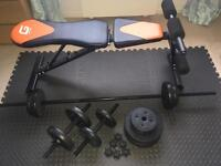 Home gym equipment. Weights, dumbells, bench