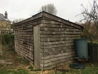 Large bespoke wooden shed/workshop approx 15ft L x 8ft W x 7.5ft H Can be unbolted into panels