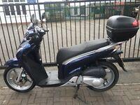 Sale honda sh125 year 2010 mile 7500 miles in blue