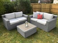 Beautiful rattan garden sofas in grey with matching coffee table