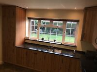 Country Pine Fitted Kitchen with Neff Integrated Appliances and Emerald Pearl Granite Worktops