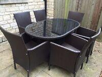 DARK BROWN RATTAN EFFECT/PLASTIC GARDEN TABLE & CHAIRS