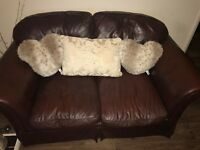 Laura Ashley brown leather two seater sofa, excellent conditon, £30, collection only ASAP