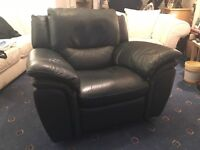 Blue leather rocking/recliner armchair