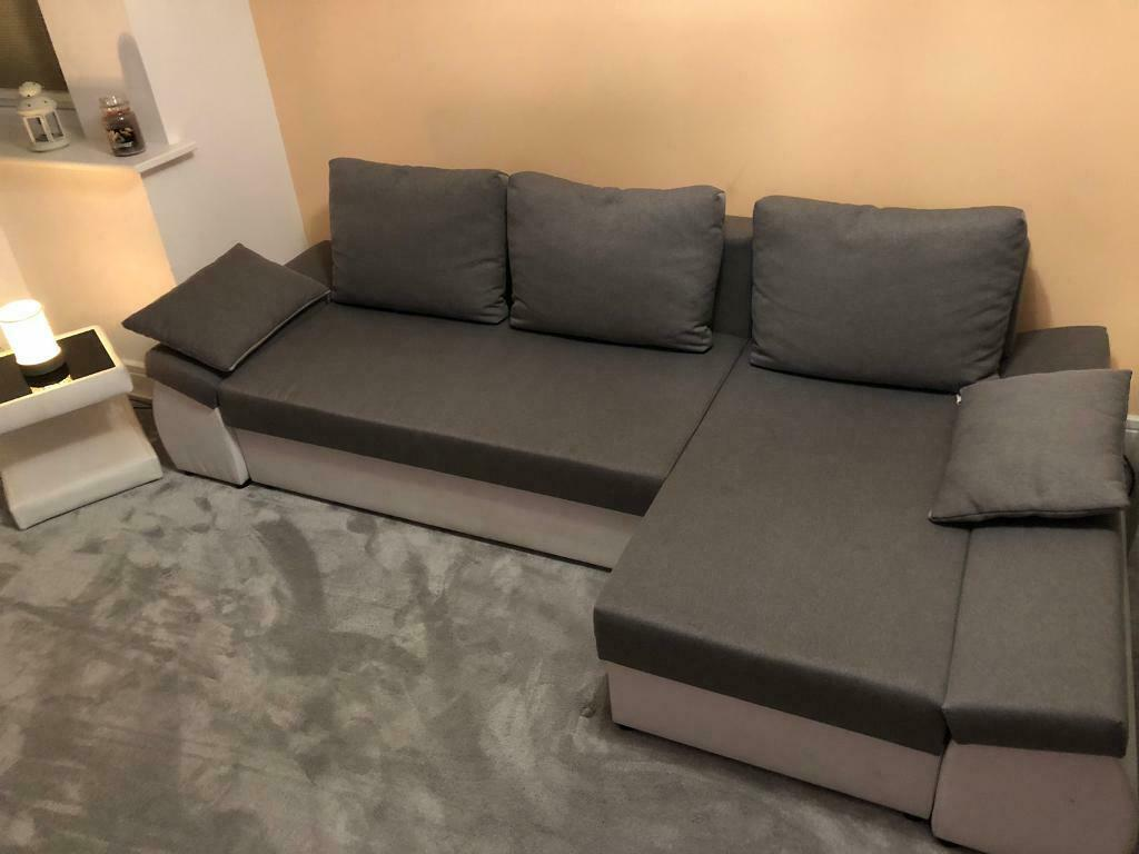 Lovely Modern Corner Sofa Bed With Storage Compartments And Cushions