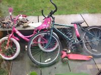 Kids bikes, pink girls age 5-7, green boys racer age 7-10 approx. Both vintage raleigh
