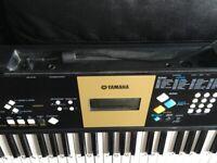 Yamaha electric keyboard with case