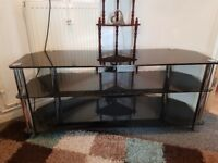 Large glass tv stand will hold up to a 55 inch tv