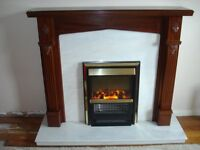 Mahogany fire surround with marble hearth and electric fire