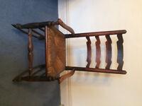 Antique ladderback rocking chair