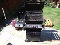 Gas Barbecue, two burner grill plus side hob.