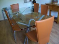 glass topped oblong dining table with solver coloured chairs. 180 x 80cm. Table only. chairs extra.