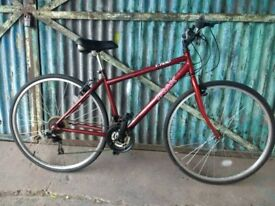 TRAX T700 hybrid bike in red. very good condition 106
