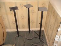 3 Tall speaker stands with adjustable height..dusty but good condition