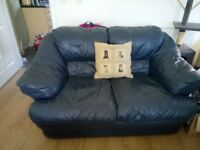 2 seater leather sofa in blue..excellent condition...as new..buyer to collect