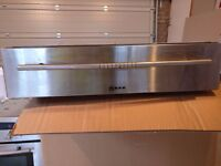 Used, good condition, Neff built-in warming drawer available for collection