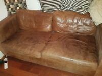 Quality, comfy, well used leather sofa bed - FREE to a deserving home.
