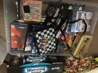 Box of mixed computer games memory cards