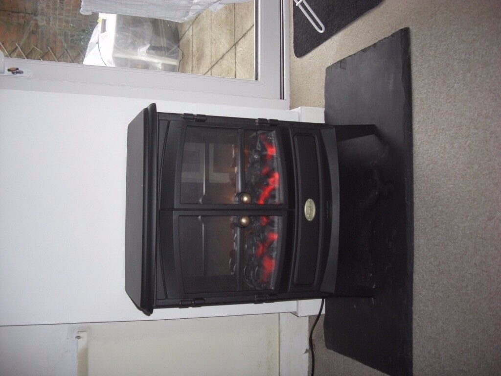 electric imitation coal burning heater,with remote control,perfect condition with slate like stand.