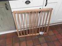 Wooden stair gate, adjustable.