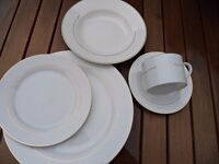 5-piece place setting in un- branded china. White with gold effect pinstripe.