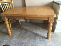 Sturdy Wooden table with 4 chairs