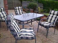 PATIO SET GARDEN TABLE GLASS TOP 150 X 90 cm + 6 STACKABLE CHAIRS WITH CUSHIONS VERY GOOD CONDITION