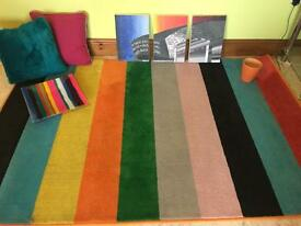 Colourful rug with cushions fanvae